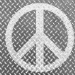 Peace symbol painted on metal floor - Stock Photo