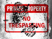 No trespassing sign painted on whiteboard with dirty footprint on it — Stock Photo