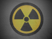 Nuclear radiation symbol painted on metall grill — Stock Photo