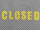 Closed caption painted on metal floor — Stock Photo