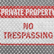 Stock Photo: No trespassing sign painted on metal floor