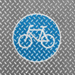 Bicycle road sign painted on metal floor — Stock Photo #15010309