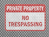 No trespassing sign painted on metal floor — Stock Photo