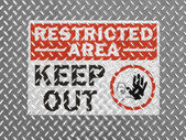 Restricted area sign painted on metal floor — Stock Photo