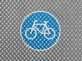 Bicycle road sign painted on metal floor — Stock Photo