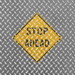 Stop ahead road sign painted on metal floor — Stock Photo
