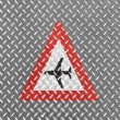 Low flying aircraft or sudden aircraft noise road sign painted on metal floor — Stock Photo