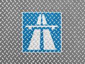 Autobahn road sign painted on metal floor — Stock Photo