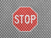 Stop road sign painted on metal floor — Stock Photo