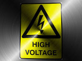 High voltage sign drawn at brushed metall — Stock Photo