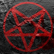 Stock Photo: Pentagram symbol painted on grunge wall with bloody palmprint over it