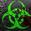 Biohazard sign painted on grunge wall with bloody palmprint over it — Stock Photo