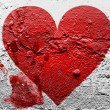 Red Heart symbol painted on grunge wall with bloody palmprint over it — Stock Photo #15376439
