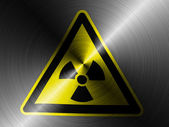 Nuclear radiation sign drawn on brushed metall — Stock Photo