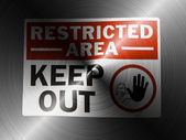 Restricted area sign painted on brushed metall — Stock Photo