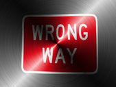 Wrong way road sign painted on brushed metall — Stock Photo
