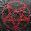 Stock Photo: Pentagram symbol painted on grunge wall