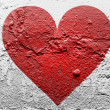 Red Heart symbol painted on grunge wall — Stock Photo #15385347