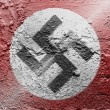 Nazi flag painted on grunge wall - Stock Photo
