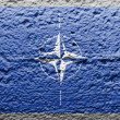 NATO symbol painted on — Stock Photo