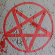 Stock Photo: Pentagram symbol painted on wall