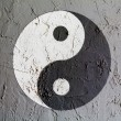 The Ying Yang sign painted on wall - Stock Photo