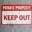Keep out sign painted on wall - Stock Photo