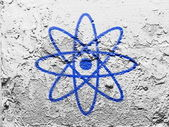 Atom symbol painted on grunge wall — Stock Photo