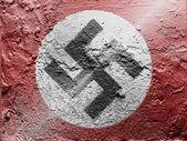 Nazi flag painted on grunge wall — Stock Photo