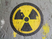 Nuclear radiation symbol painted on wall — Stock Photo