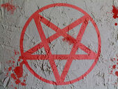 Pentagram symbol painted on wall — Stock Photo