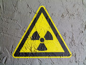 Nuclear radiation sign drawn on wall — Stock Photo
