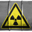 Nuclear radiation sign drawn on oil barrel — Stock Photo
