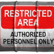 Restricted area sign painted on oil barrel - Stock Photo