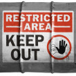 Restricted area sign painted on oil barrel — Stock Photo #15392521