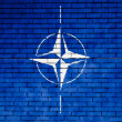 NATO symbol painted on - Stock Photo