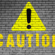Caution sign painted on — Stock Photo