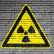 Nuclear radiation sign drawn on — Stock Photo