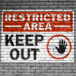 Restricted area sign painted on — Stock Photo