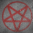 Stock Photo: Pentagram symbol painted on metal surface covered with rain drops