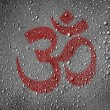 Stock Photo: Hindu symbol drawn at metal surface covered with rain drops