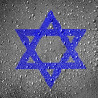 Jewish star painted on metal surface covered with rain drops - Stock Photo