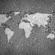 World map drawn on metal surface covered with rain drops - Stock Photo