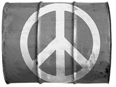Peace symbol painted on oil barrel — Stock Photo