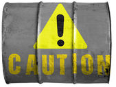 Caution sign painted on oil barrel — Stock Photo