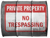 No trespassing sign painted on oil barrel — Stock Photo