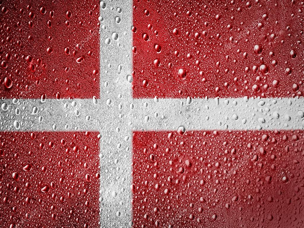 The Danish flag painted on metal surface covered with rain drops — Stock Photo #15396043