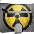 Nuclear radiation symbol painted on crocodile skin purse - 