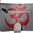 Hindu symbol drawn at crocodile skin purse - Stock Photo