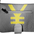 Yen sign painted on crocodile skin purse — Stock Photo